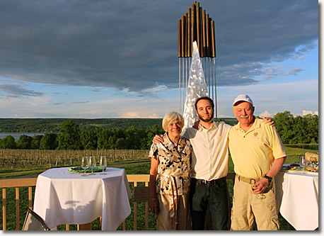 Carol, Lawrence, and Jim Doolittle pose together in front of the stay sail on the winery deck